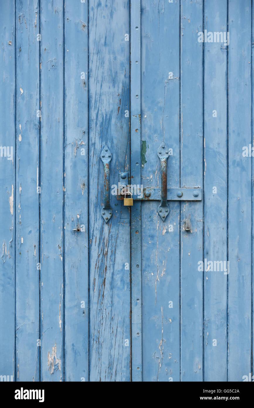Blue doors with padlock on the door handle - Stock Image