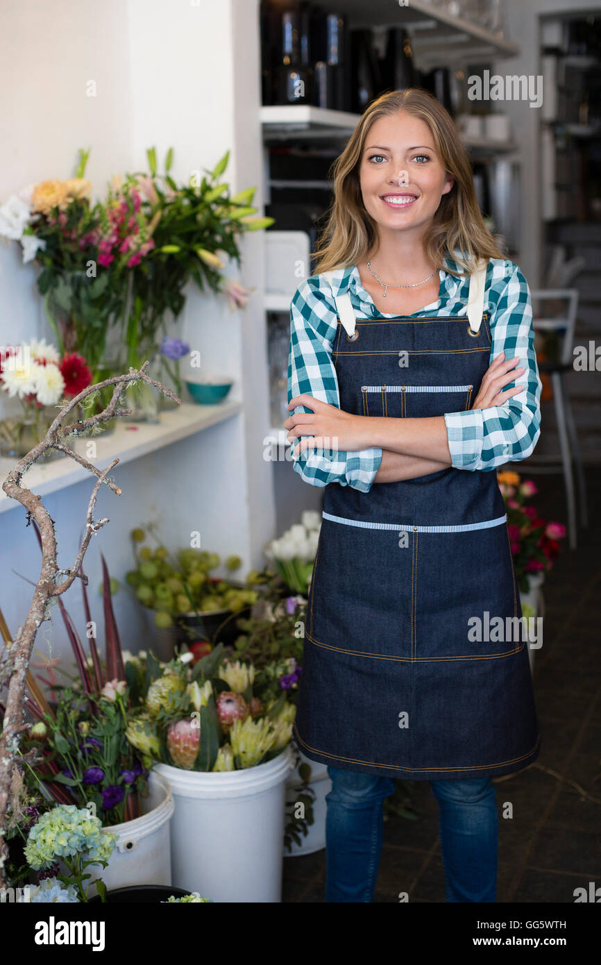 Portrait of a happy florist - Stock Image