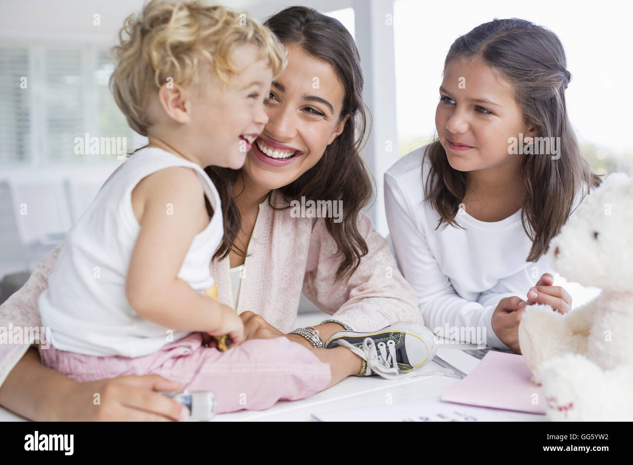 Mother playing with children at home Stock Photo