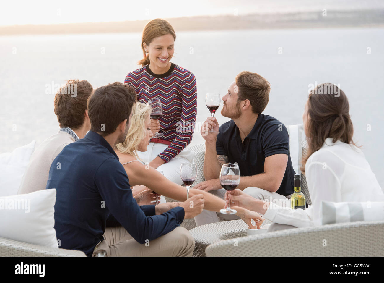 Group of friends enjoying wines at outdoors party - Stock Image