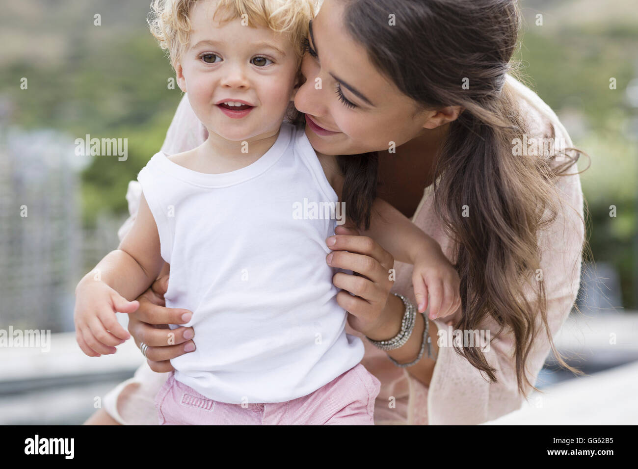 Close-up of happy mother playing with son - Stock Image