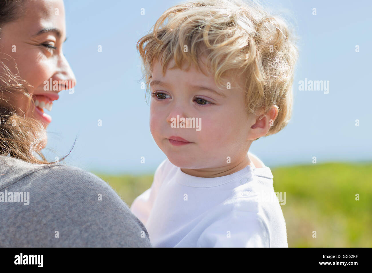Close-up of happy woman with her baby boy - Stock Image