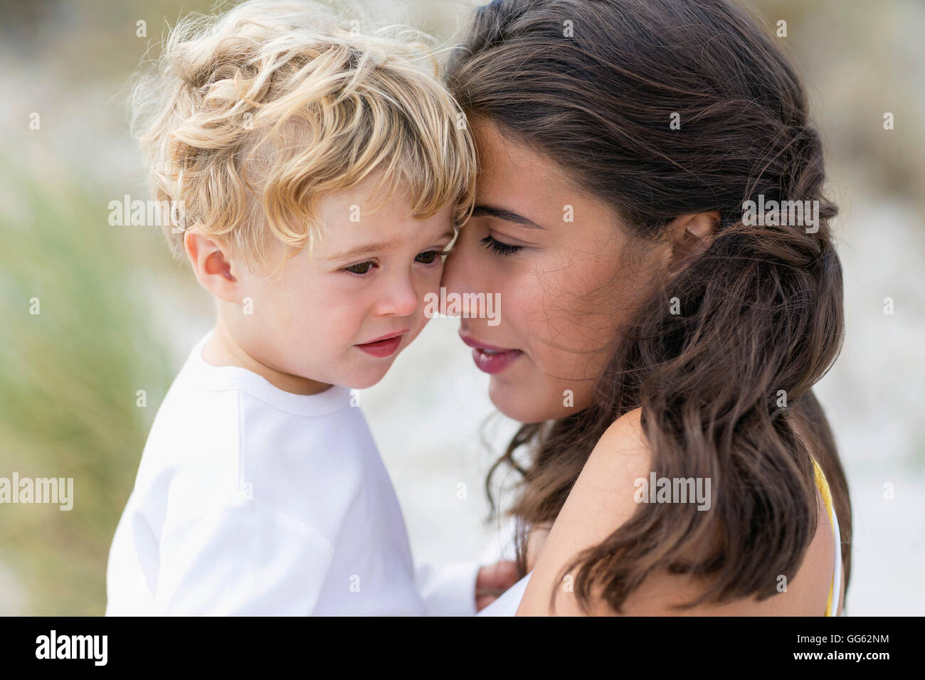 Close-up of a woman loving with her son - Stock Image
