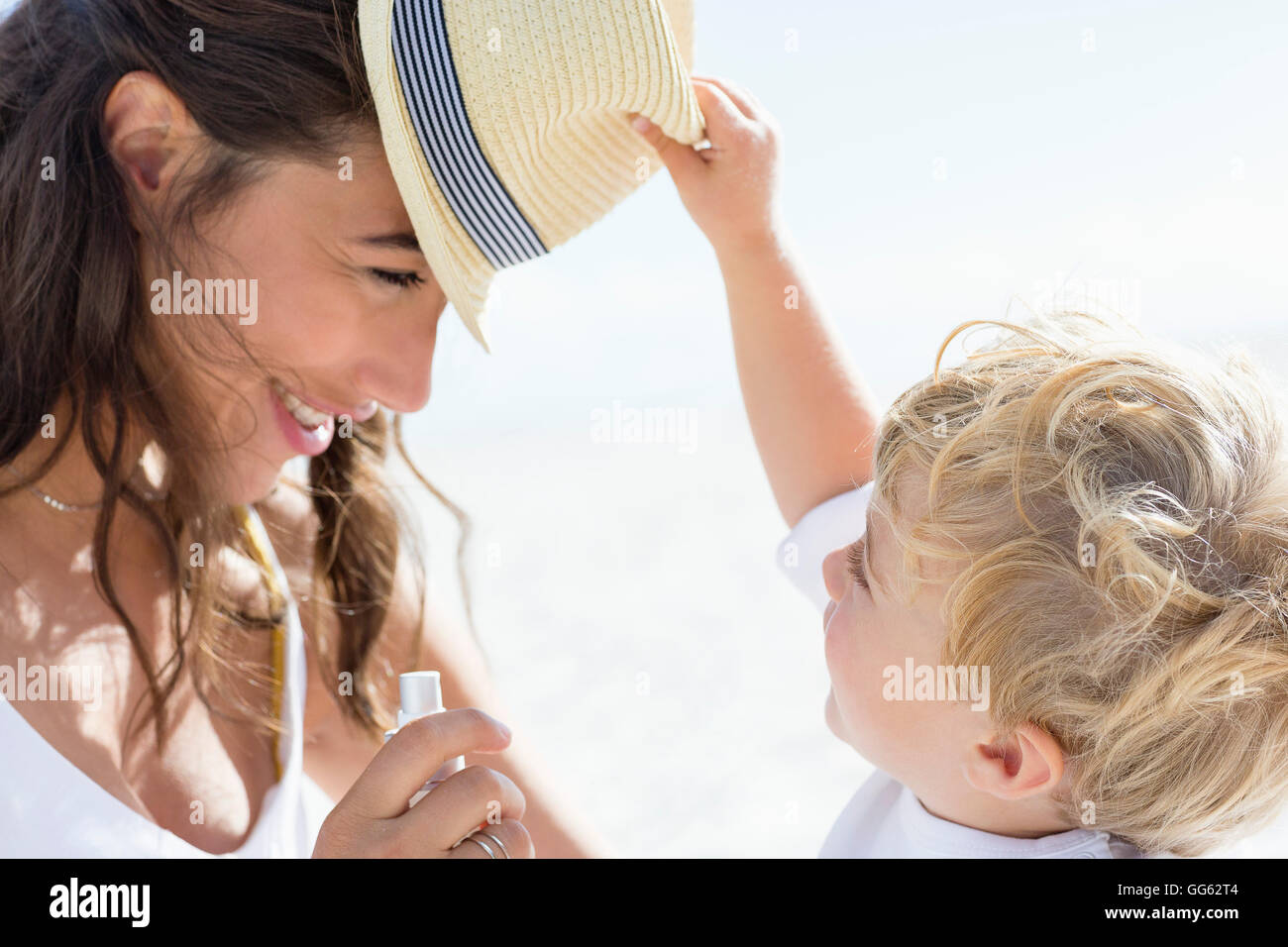 Baby boy playing with his mother - Stock Image