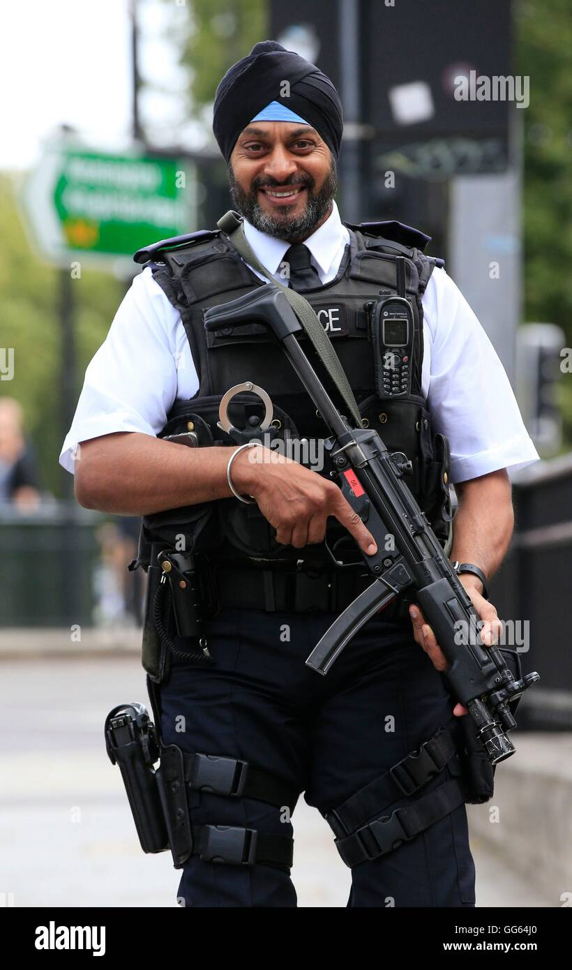 An armed Sikh police officer patrols as part of a security ...