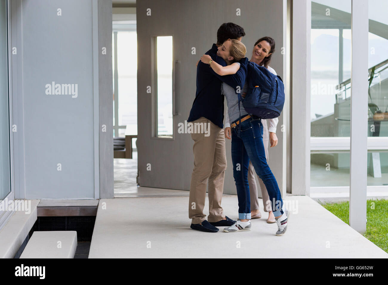 your-teen-girl-hugging-parents