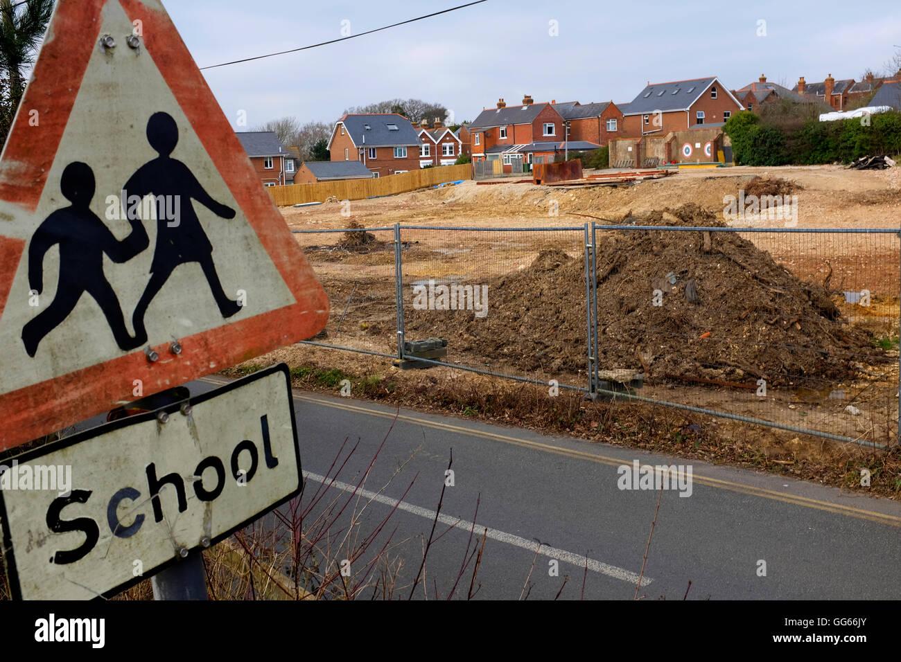 Old damaged beware School Road Sign, next to demolished primary school, Gurnard Isle of Wight UK Stock Photo