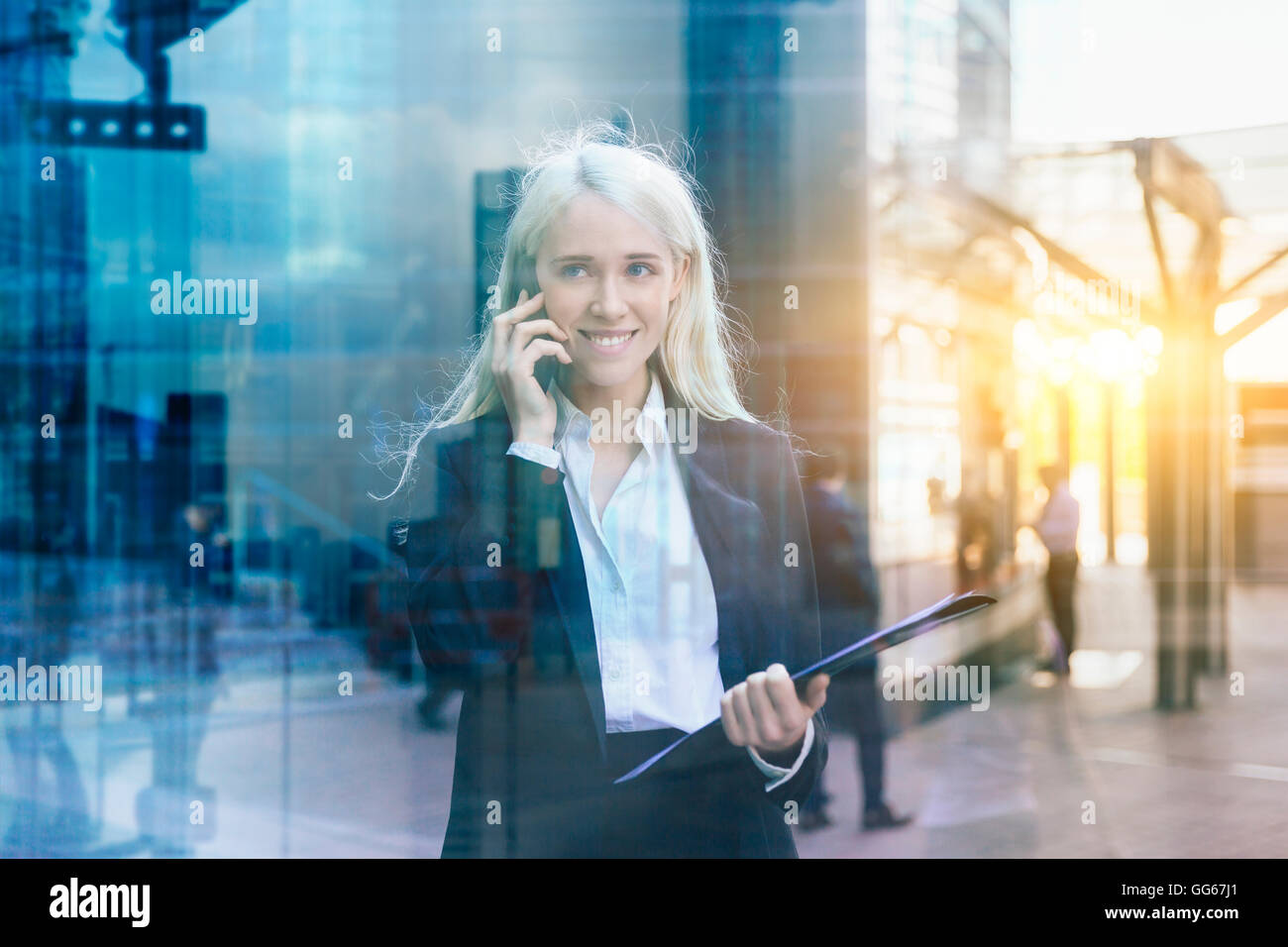 Businesswoman using a mobile phone - Stock Image
