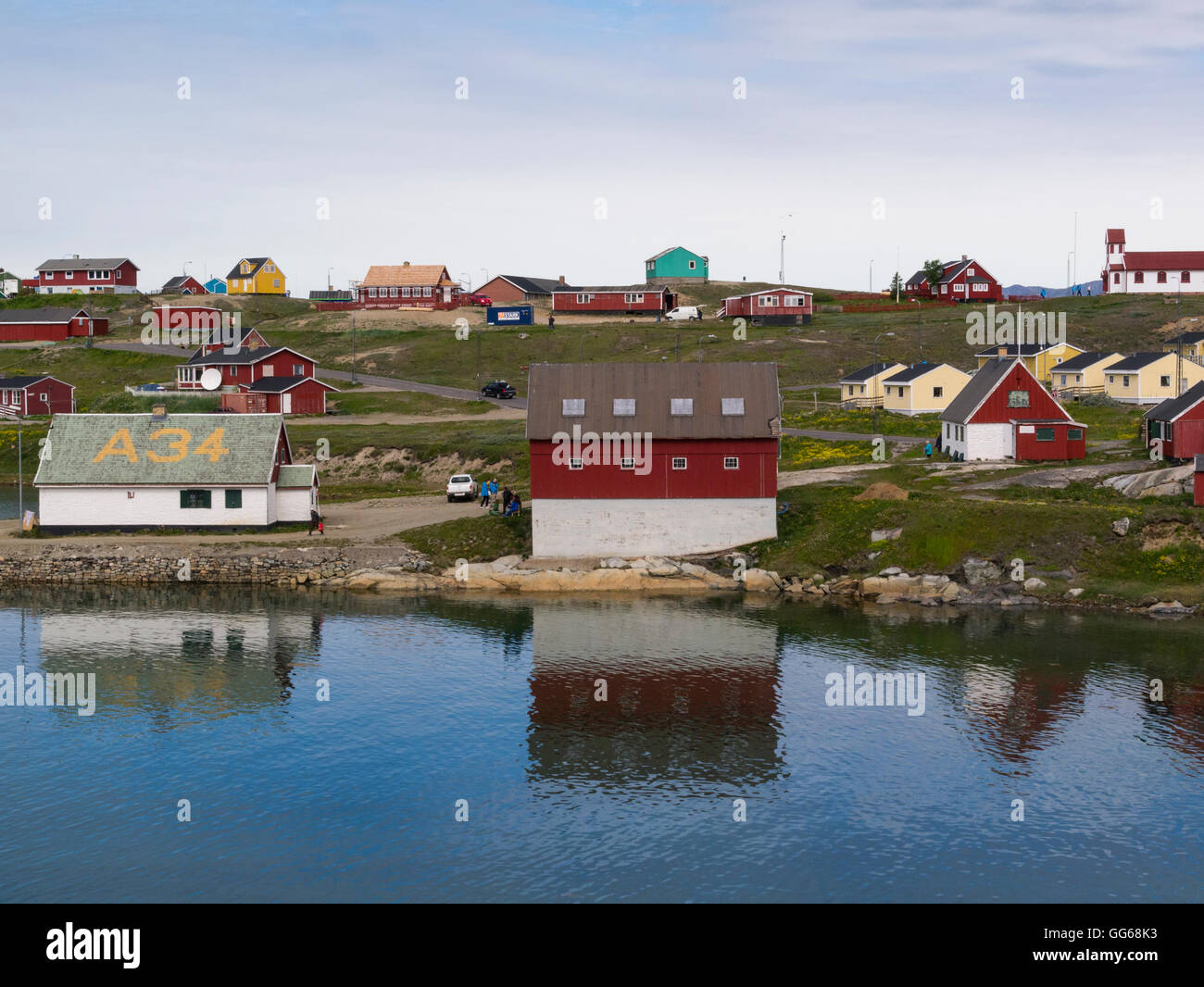 View across Tunulliarfik  Fjord to Narsaq Museum buildings Southern Greenland in this small fishing community in Stock Photo