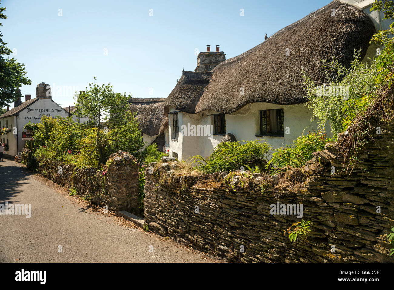 Ancient thatched cottage and The Journey's End Inn in the village of Ringmore in The South Hams, Devon, UK - Stock Image