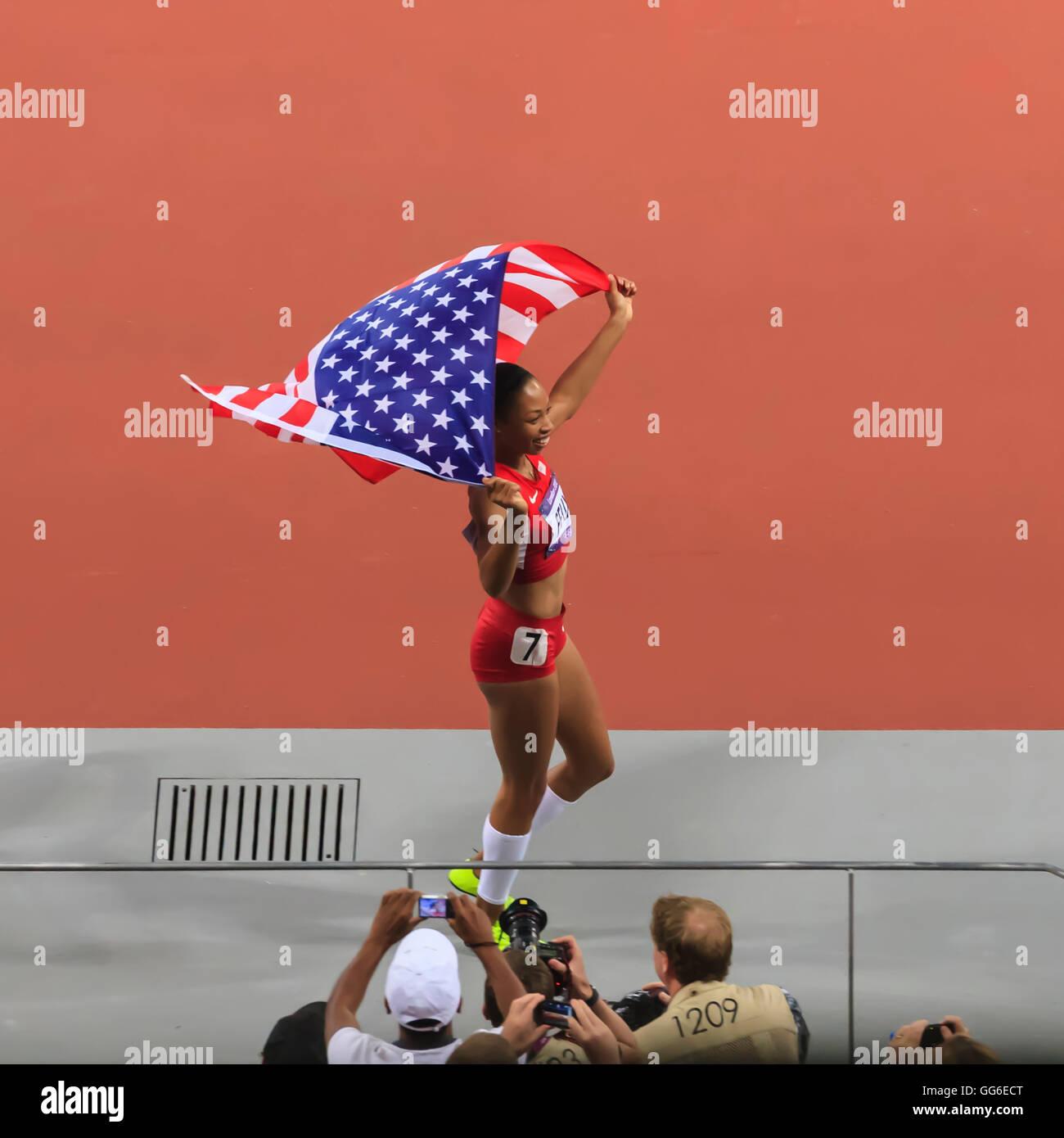 Allyson Felix, United States, celebrates with flag after winning Women's 200m, Stadium, London 2012, Olympic - Stock Image