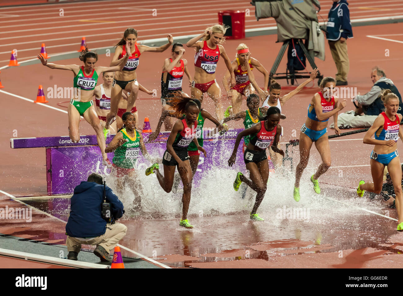 Competitors, Women's 3000m steeplechase final, splash over water hurdle, Olympic Stadium, London 2012, Olympic Games, Stock Photo
