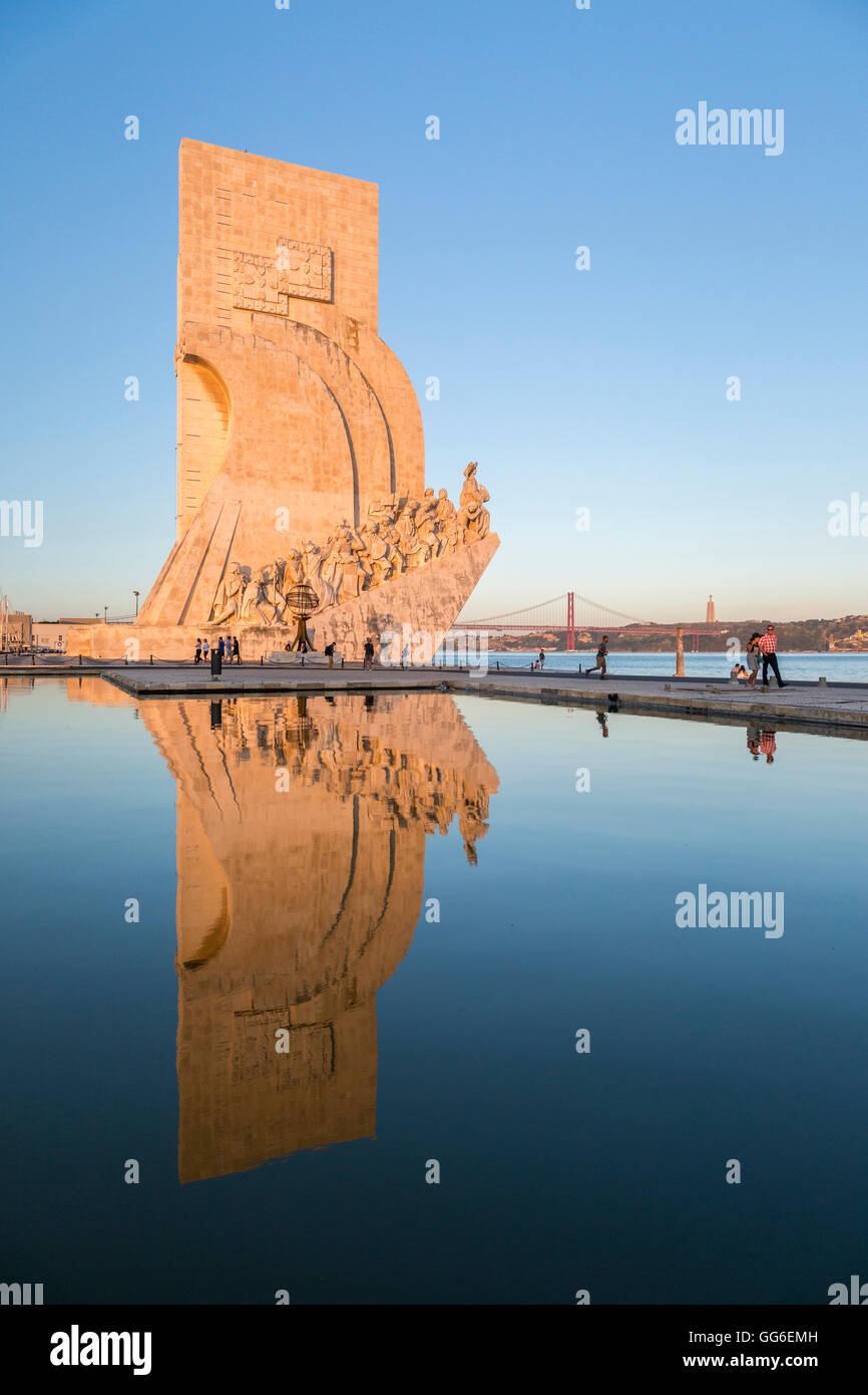 Sunset on the Padrao dos Descobrimentos (Monument to the Discoveries) reflected in Tagus River, Belem, Lisbon, Portugal, - Stock Image