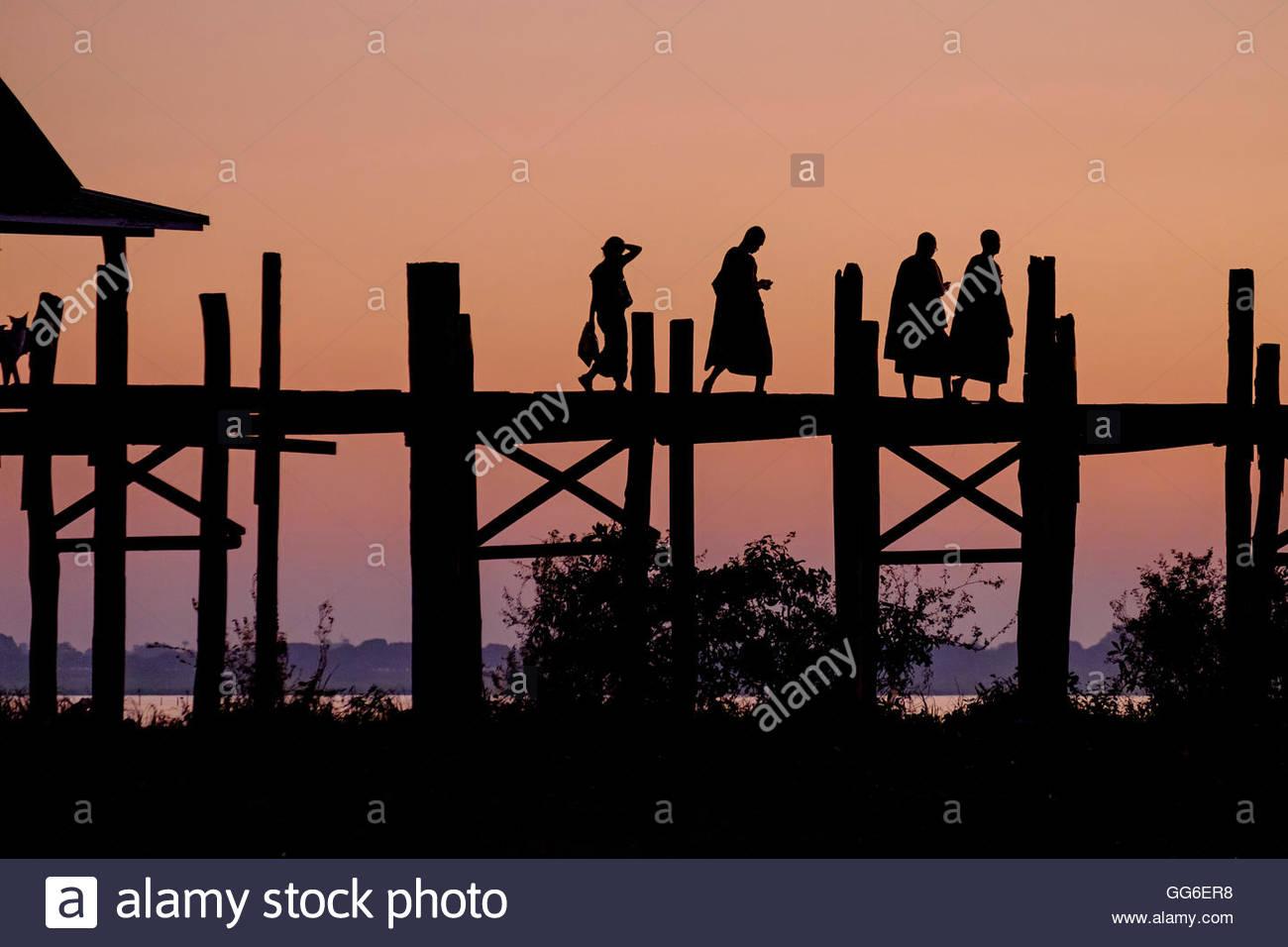 Sunset over U Bein Bridge, Taungthman Lake, U Bein, Amarapura, Myanmar (Burma), Asia Stock Photo