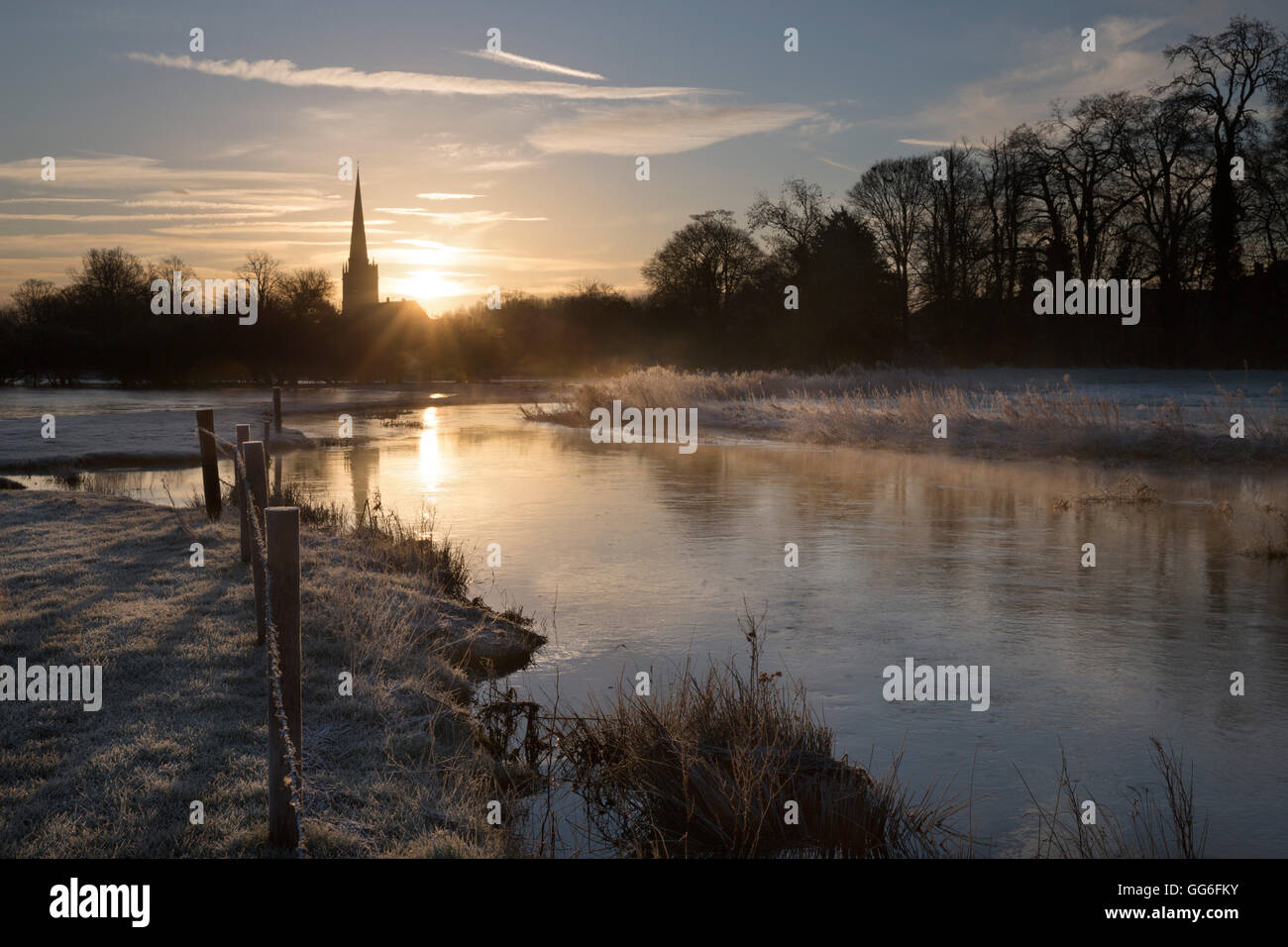 Burford church and River Windrush on frosty winter morning, Burford, Cotswolds, Oxfordshire, England, United Kingdom, - Stock Image