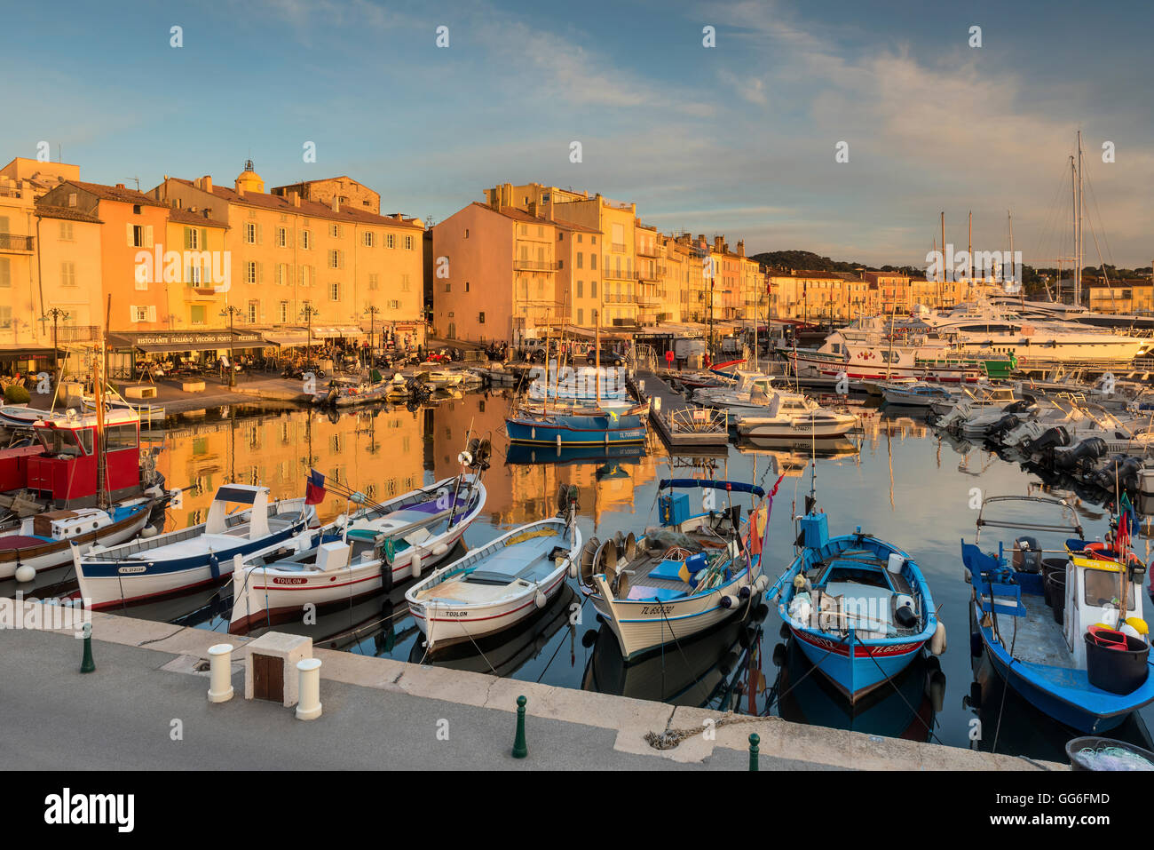 Warm evening sunlight illuminating the port of Saint Tropez, Var, Provence, Cote d'Azur, French Riviera, France, - Stock Image