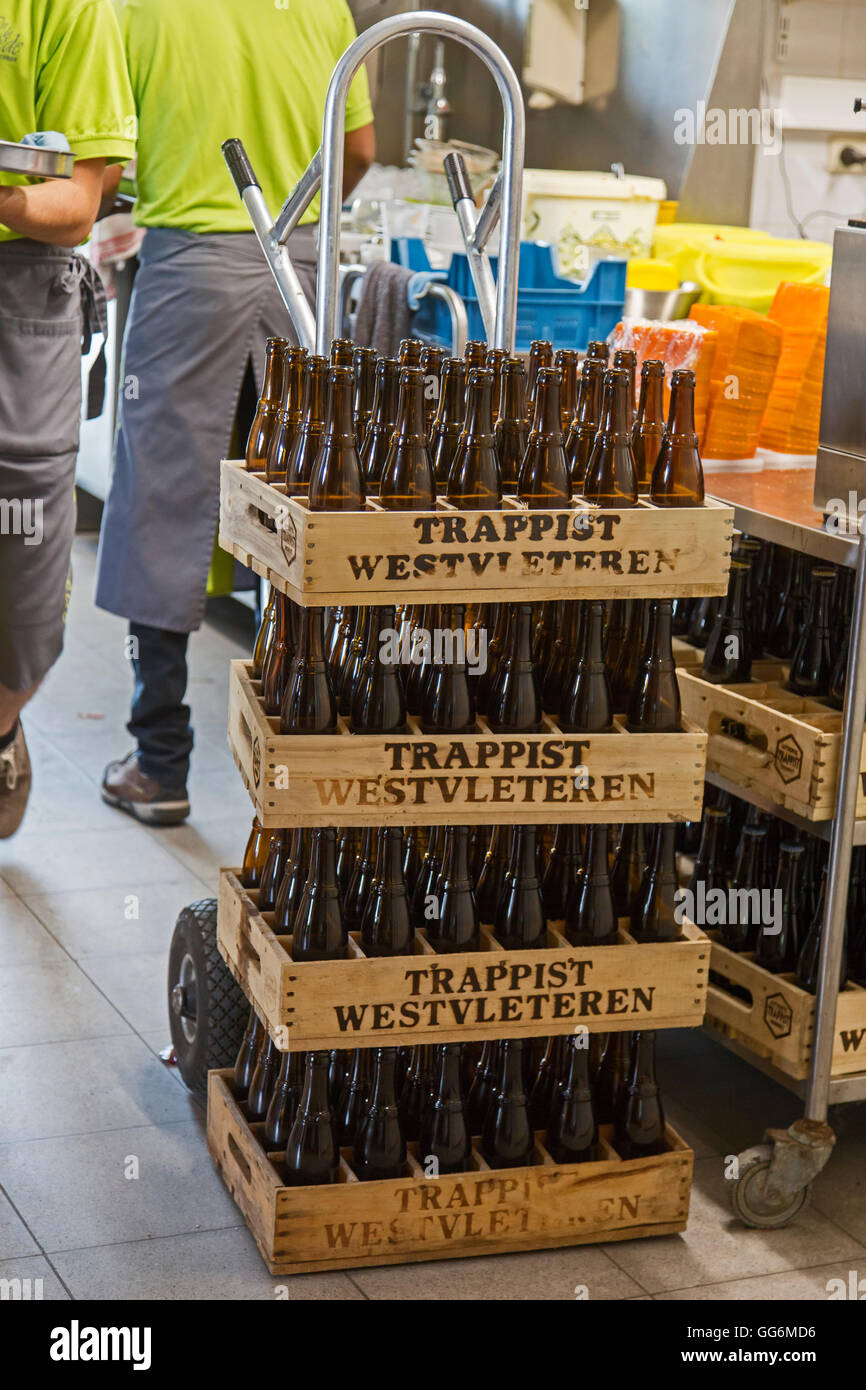 Stacked wooden beer crates with empty Trappist Westvleteren bottles on trolley - Stock Image