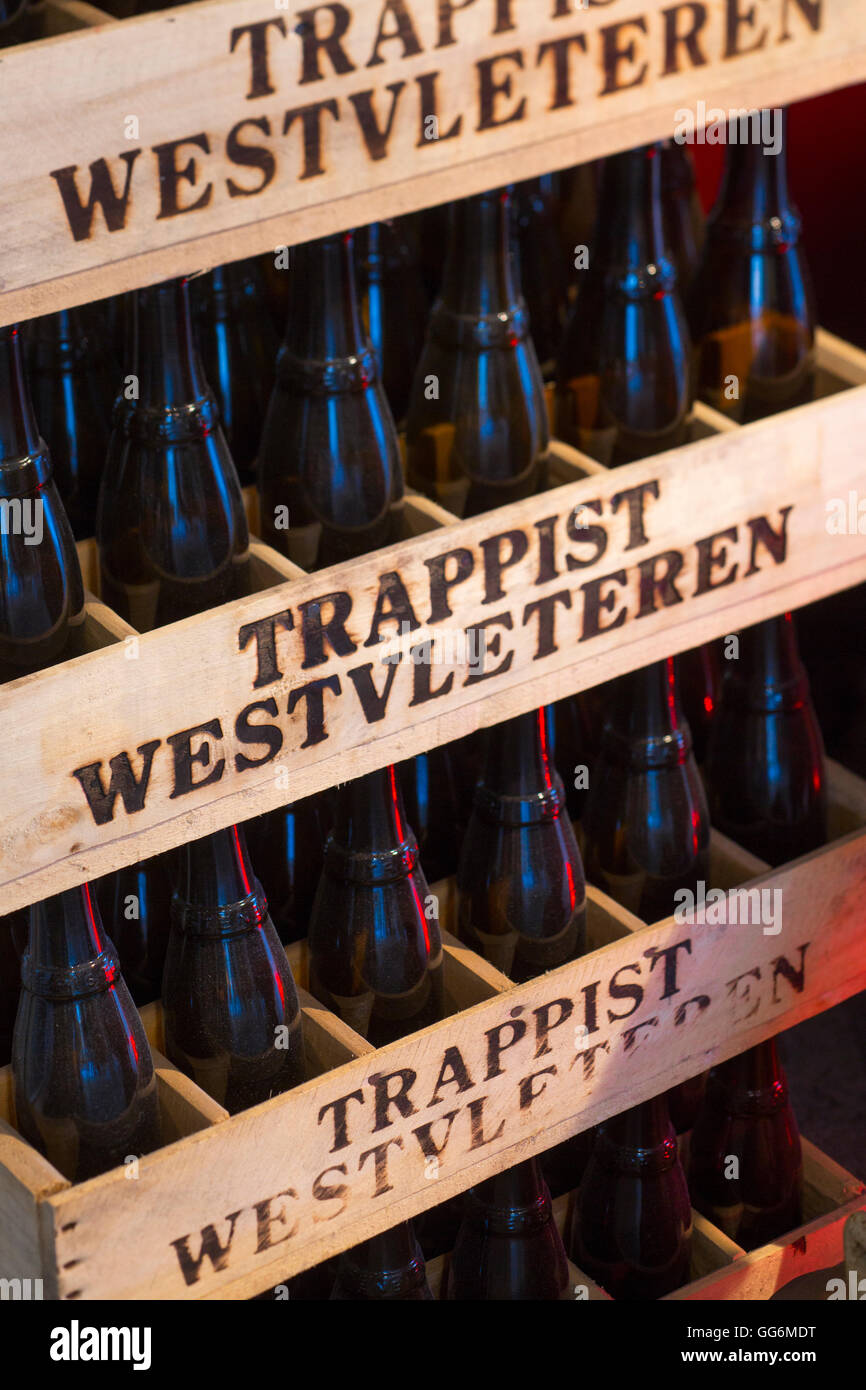 Stacked wooden beer crates with Trappist Westvleteren bottles - Stock Image
