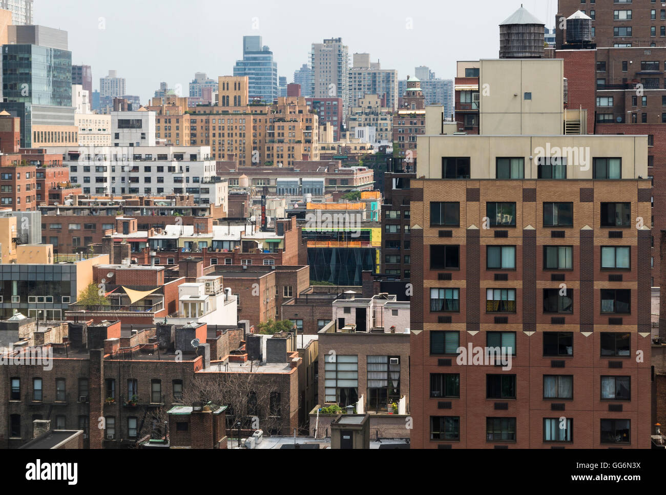 View of rooftops and buildings in skyline of Lenox Hill area of New York City - Stock Image