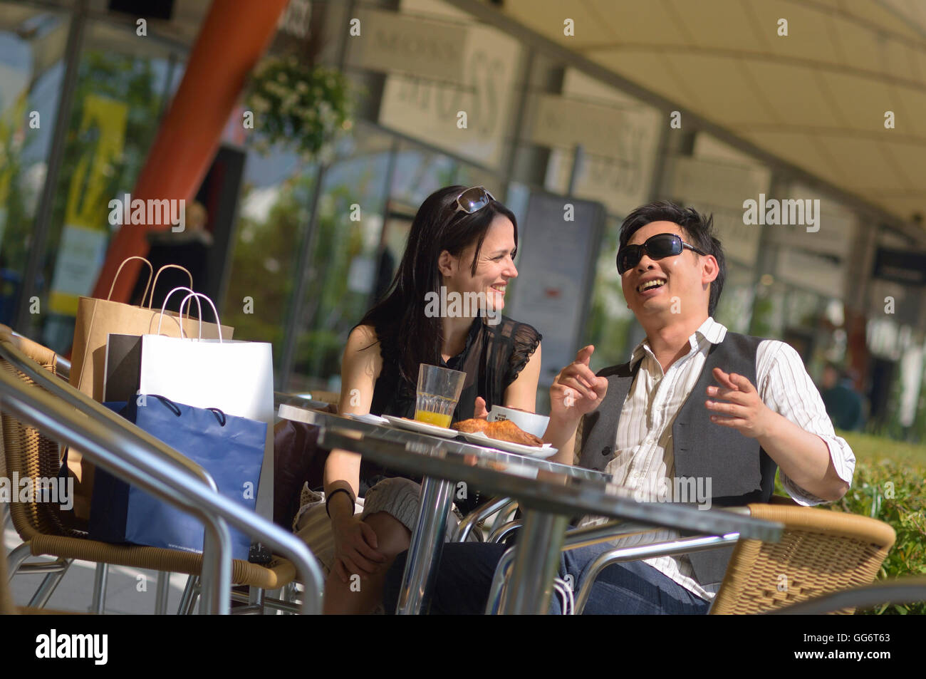 Young adult couple having brunch at a retail outlet. England. UK - Stock Image