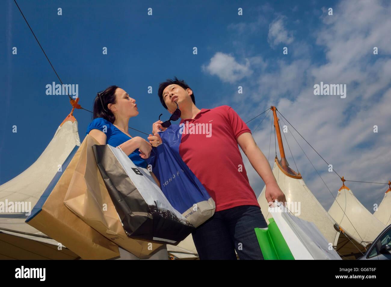 A couple shopping. England. UK - Stock Image