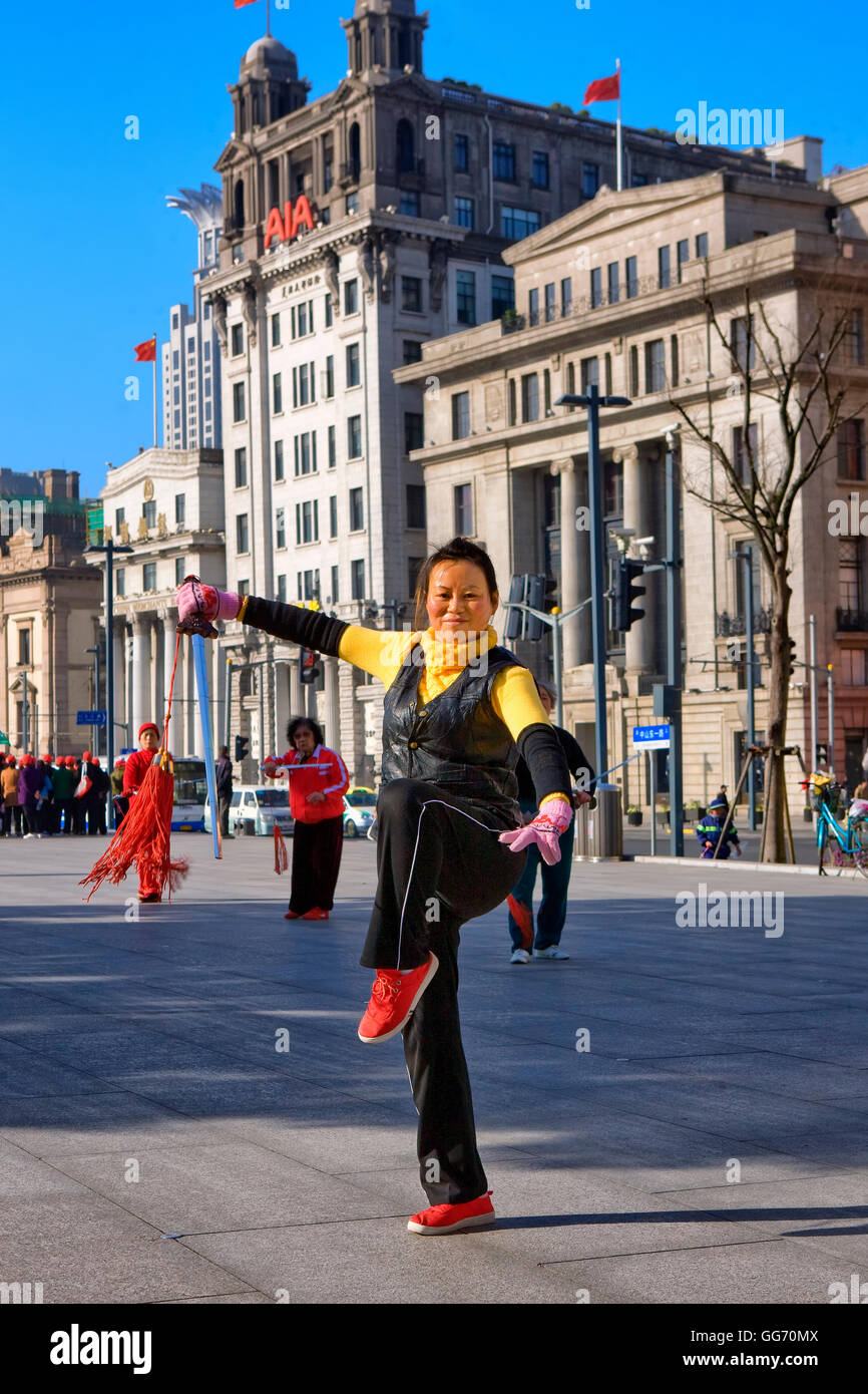 Mature woman performing Tai Chi exercise on the Bund , Shanghai, China - Stock Image
