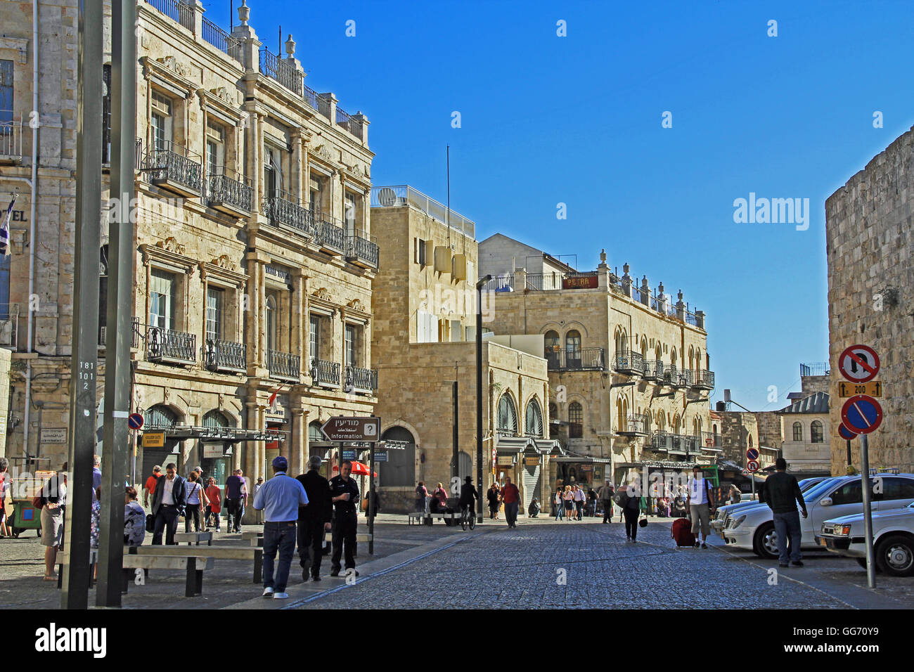 Street entrance to Old Jerusalem just inside Jaffa Gate busy with tourists visiting shops. - Stock Image