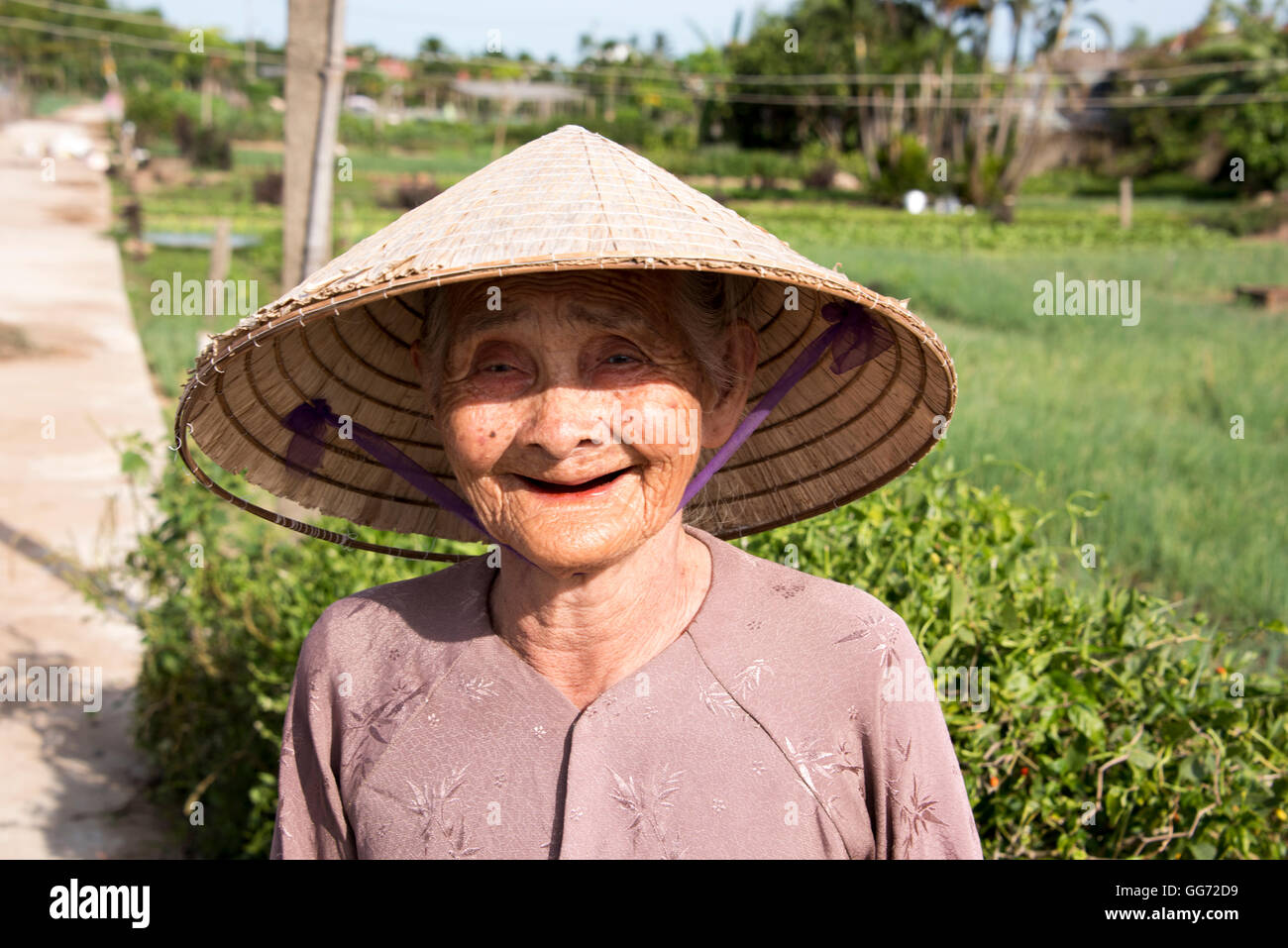 835496f7d73 Old Vietnamese lady wearing conical hat living in the countryside near Hoi  An. - Stock