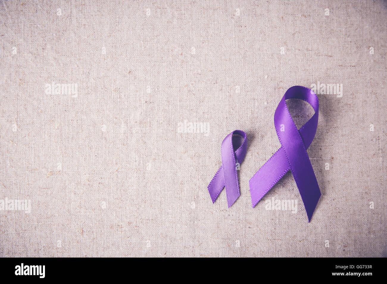 Purple ribbons toning copy space background, Alzheimer's disease, Pancreatic cancer, Epilepsy awareness, Hodgkin's - Stock Image
