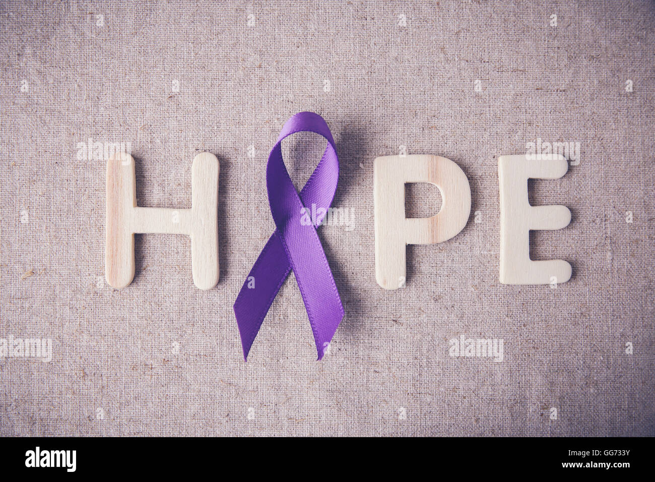 Purple ribbon with HOPE wooden letter, toning, Alzheimer's disease, Pancreatic cancer, Epilepsy awareness, Hodgkin's - Stock Image