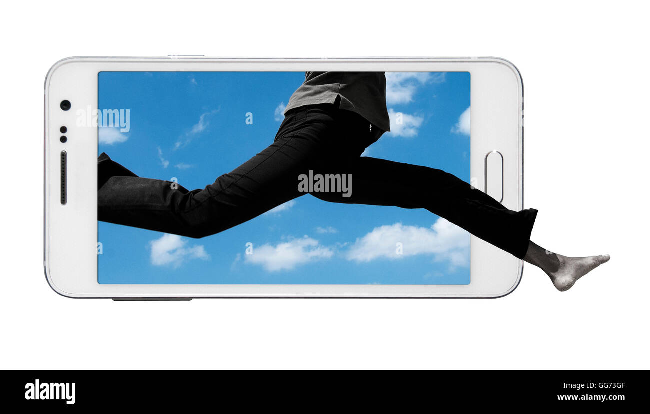 Bottom portion of human body jumping from within the smart phone screen outside. Front feet extending beyond the - Stock Image