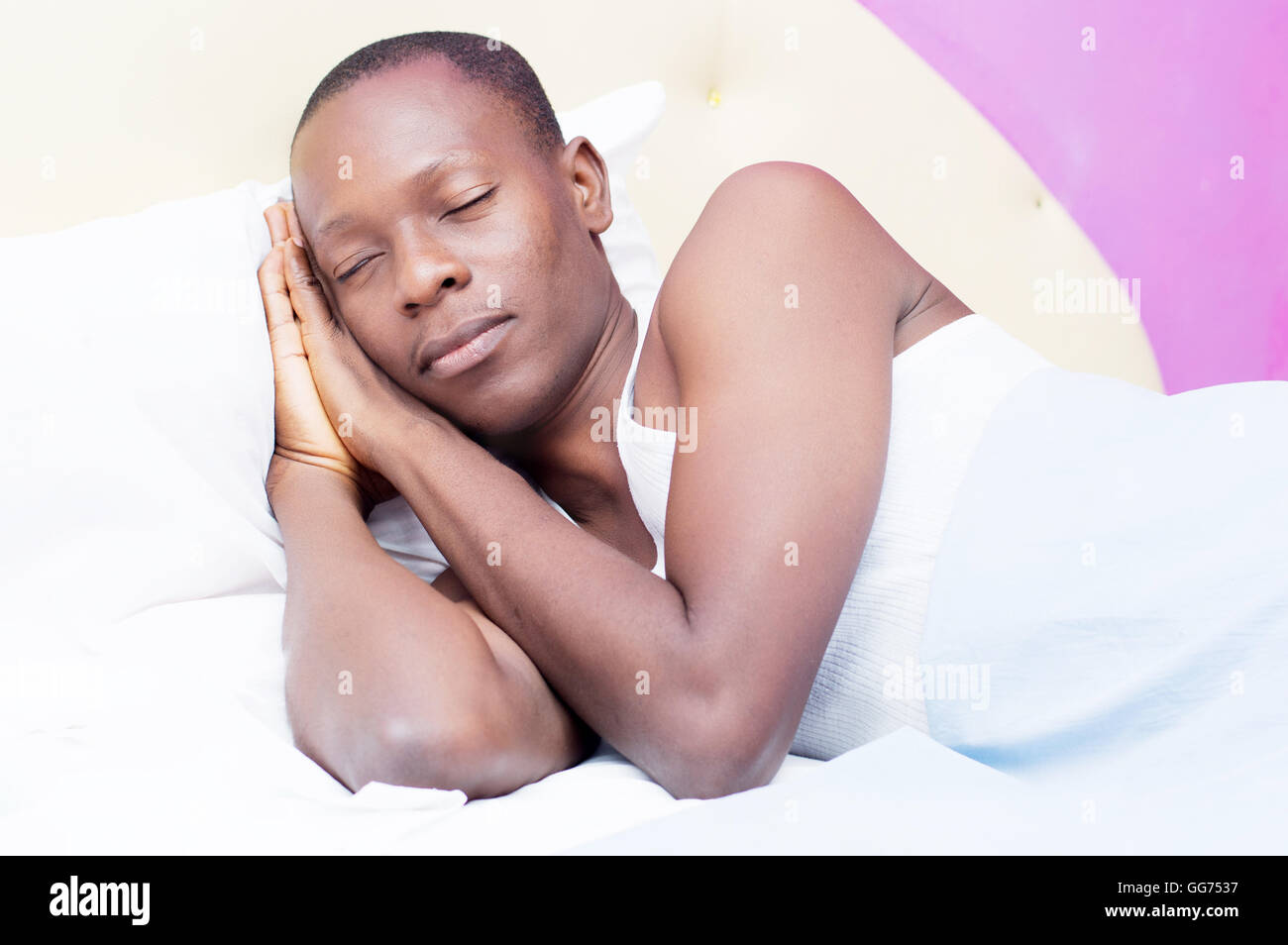 young tired man is in a deep sleep. - Stock Image