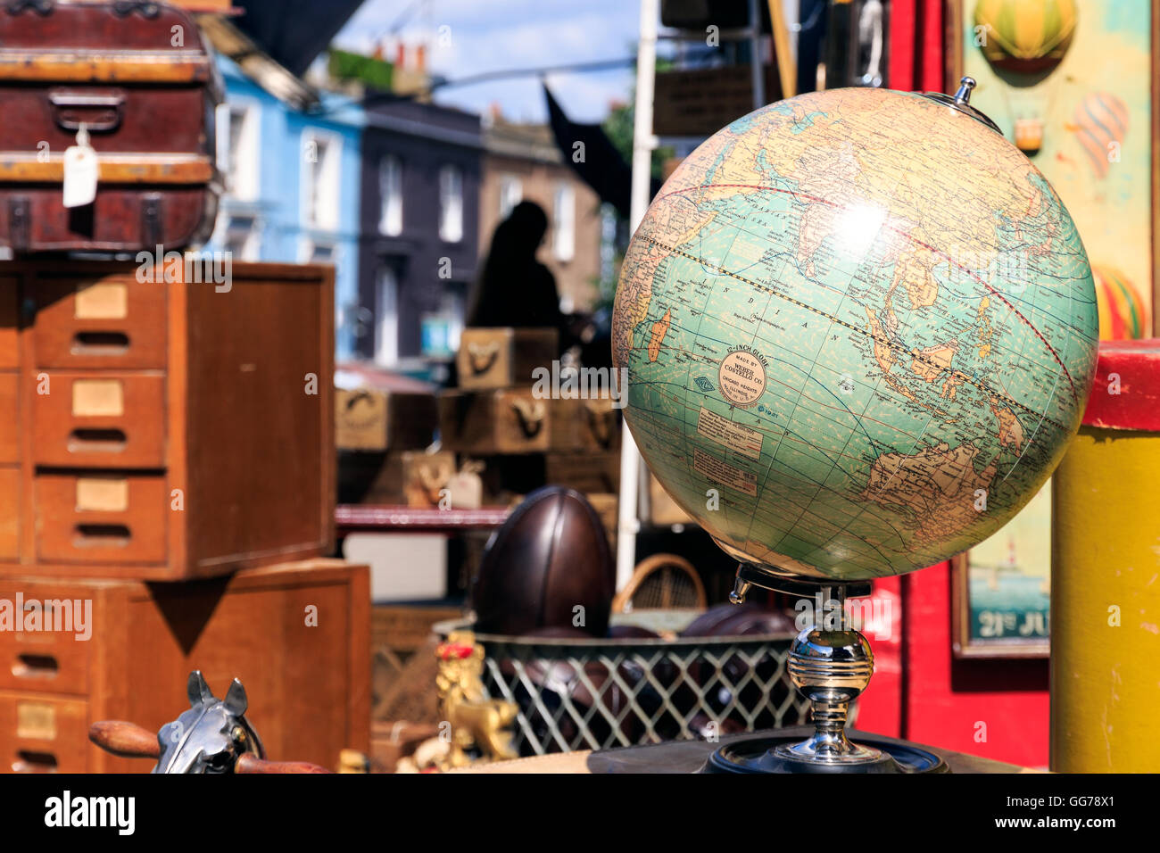 Vintage Globe displayed outside an antique shop at Portobello Road Market in Notting Hill - Stock Image