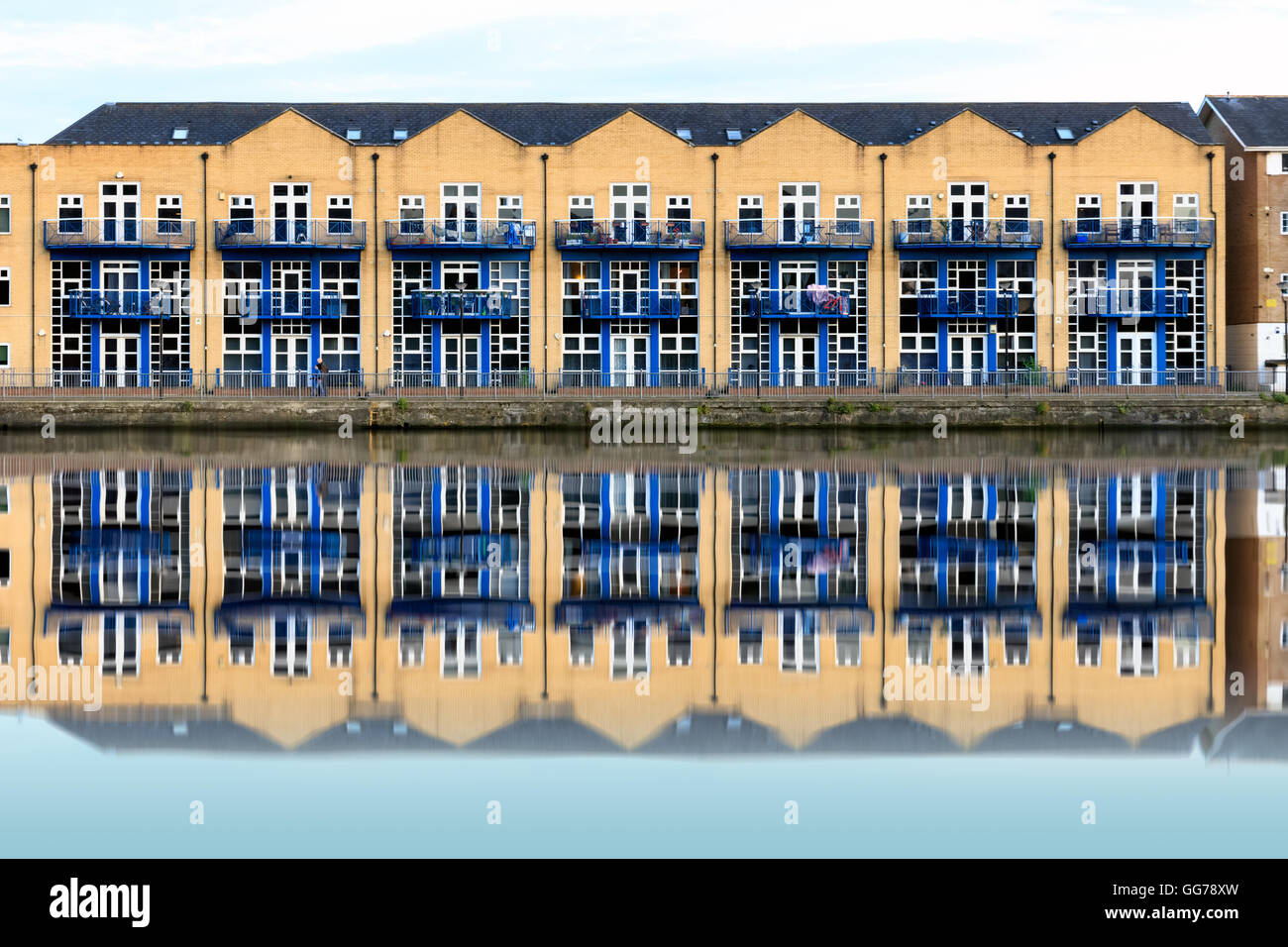 Terraced houses along Millwall Outer Dock in London, UK - Stock Image