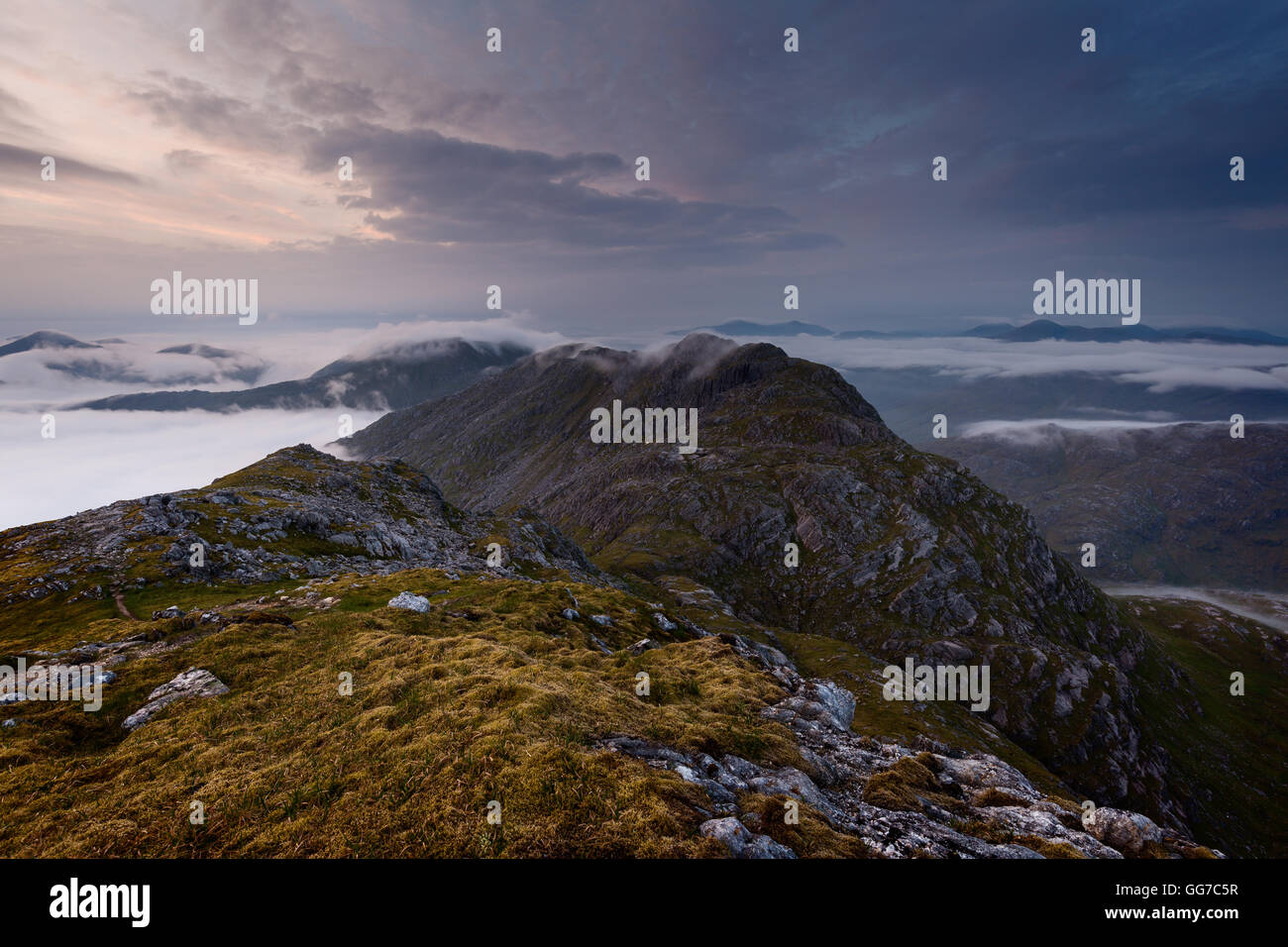 Muted colours above Garbh Chioch Mhor at sunrise - Stock Image