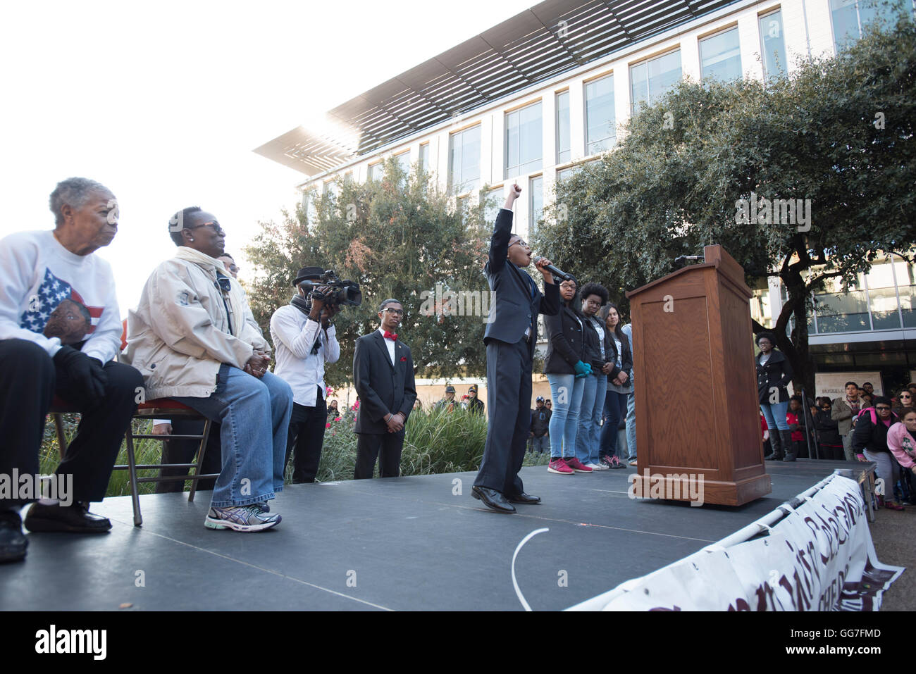 Young black student speaks to crowd during oratory competition at Martin Luther King Day celebration in Austin, - Stock Image