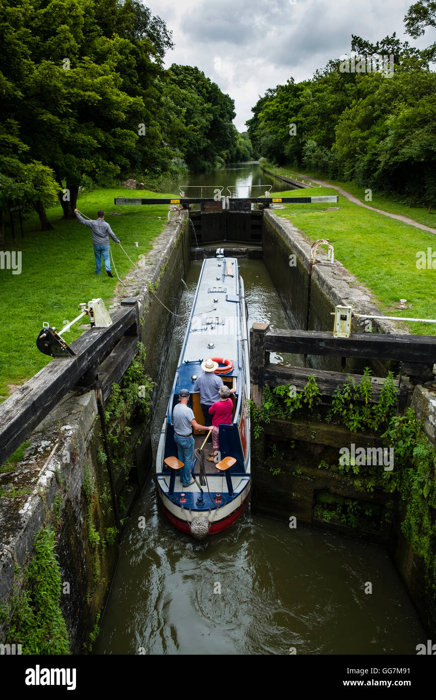 Narrow boat entering lock on Kennet and Avon Canal in Wiltshire England, United Kingdom - Stock Image