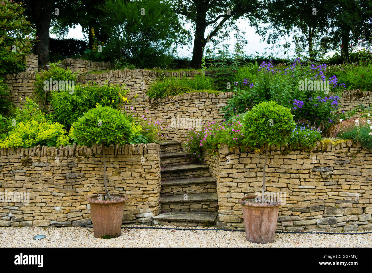 Beau View Of Country Terraced Domestic Garden Made From Walls Of Cotswold Stone  In England, United