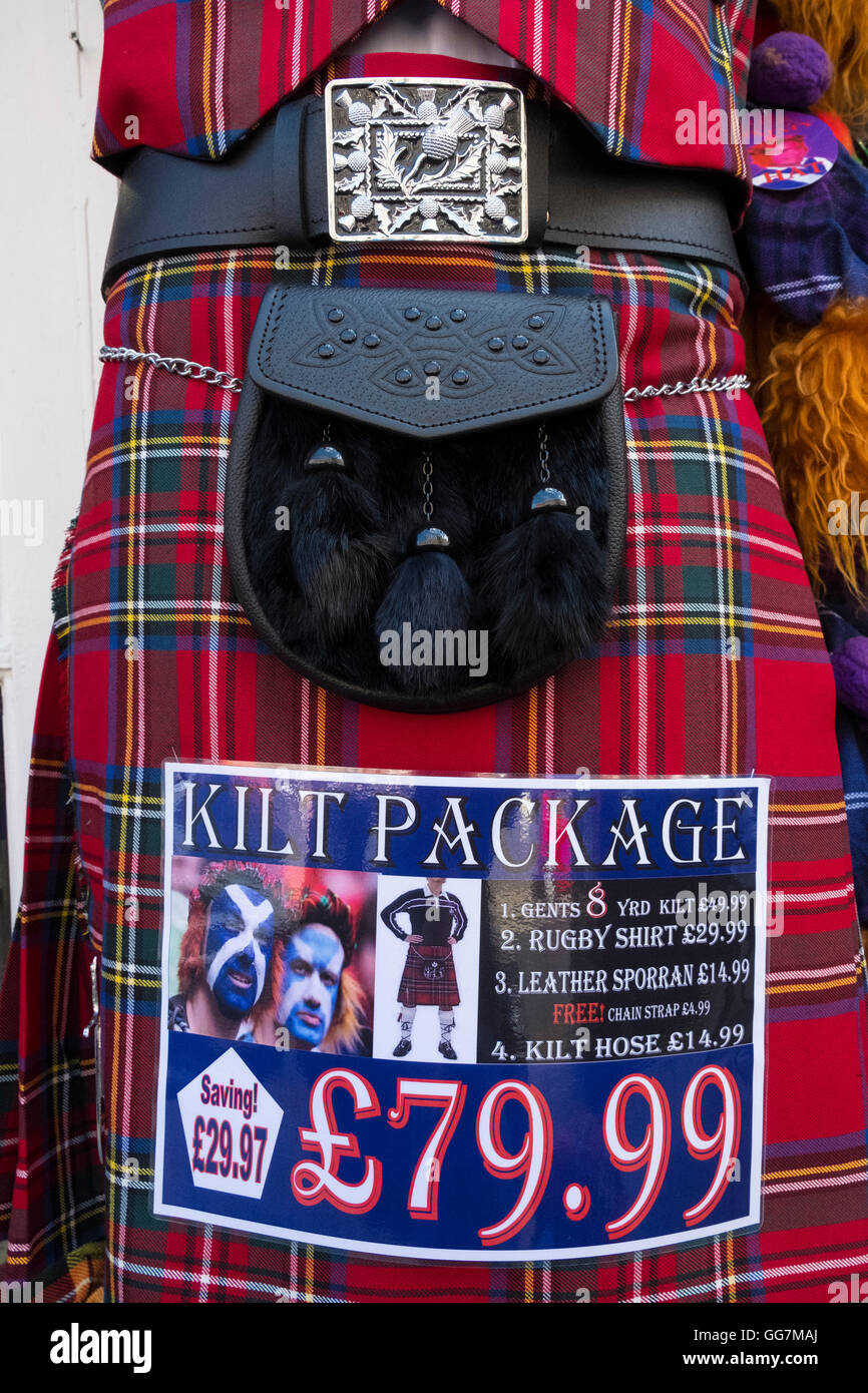 Close up of traditional Scottish tartan kilt and sporran package for sale in tourist shop in Edinburgh Scotland, - Stock Image