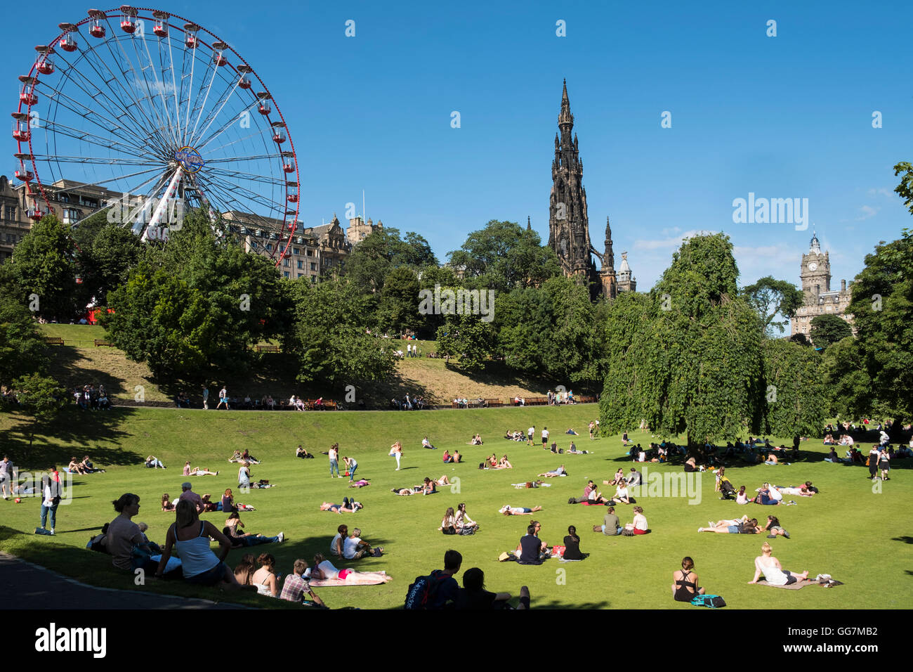 Summer hot weather brings many people into Princes Street Gardens in Edinburgh, Scotland, United Kingdom - Stock Image