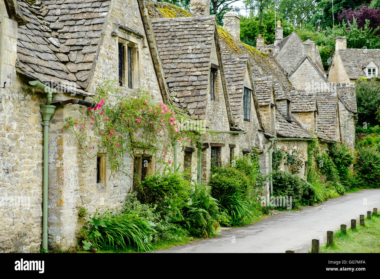 Arlington Row historic former weavers cottages in Bibury ,Gloucestershire, Cotswolds ,England - Stock Image