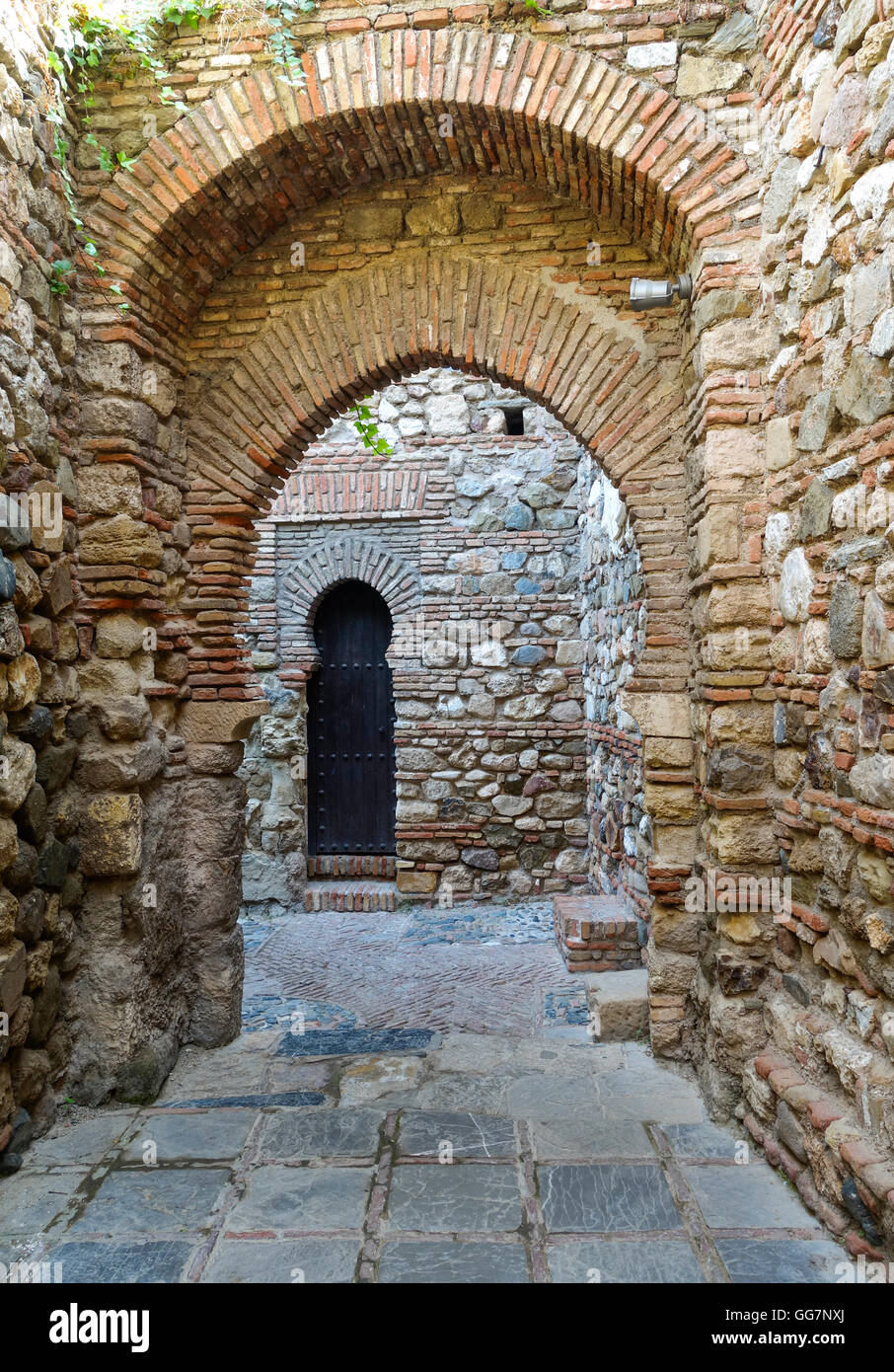 Ancient walls and horsehoe arch moorish doors Alcazaba Malaga Andalusia Spain. & Ancient walls and horsehoe arch moorish doors Alcazaba Malaga ...