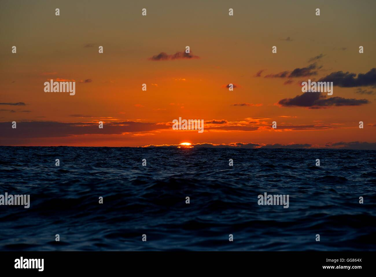 Image taken from the setting sun at sea - Stock Image