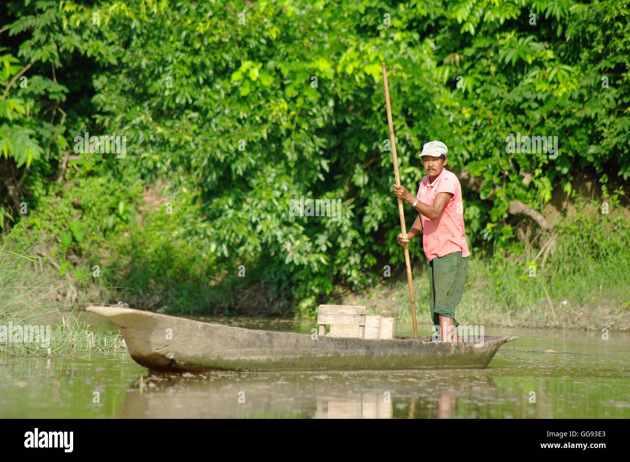 MANAUS, BR, CIRCA AUGUST 2011 - Man on a canoe on the Amazon river, circa August 2012 at Manaus, BR. - Stock Image
