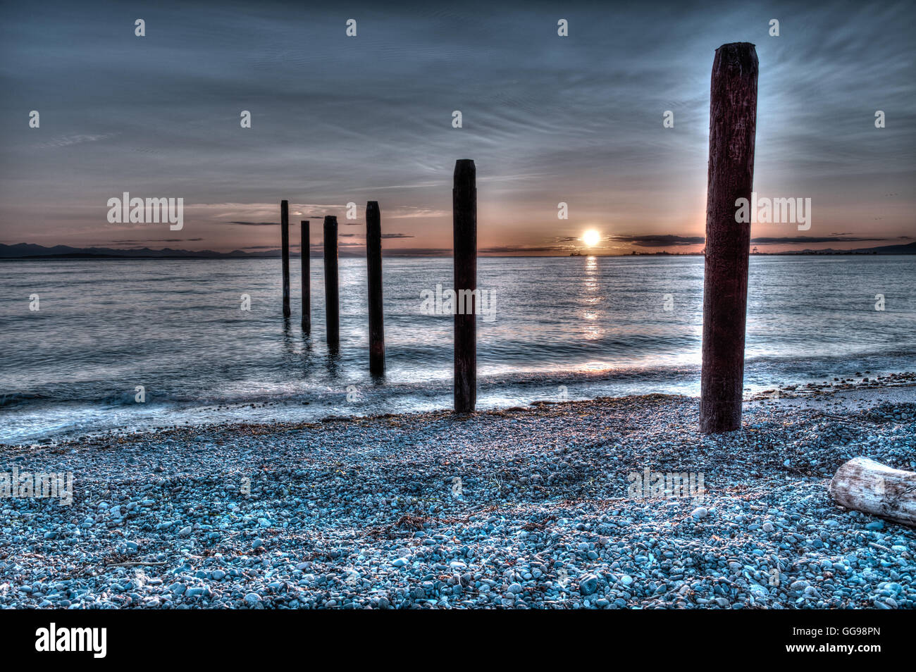 Sunset over the pilings at Point Roberts, Washington state, USA - HDR picture - Stock Image
