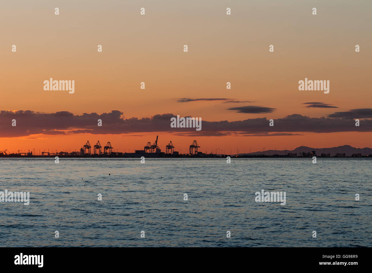 Sun dawn over the cranes from Point Roberts, Washington State, USA - Stock Image