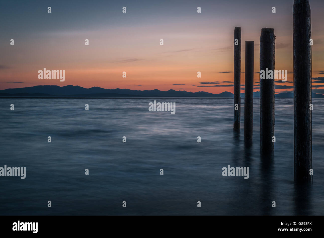 Night picture of Point Roberts pilings and silky water at night time - Stock Image