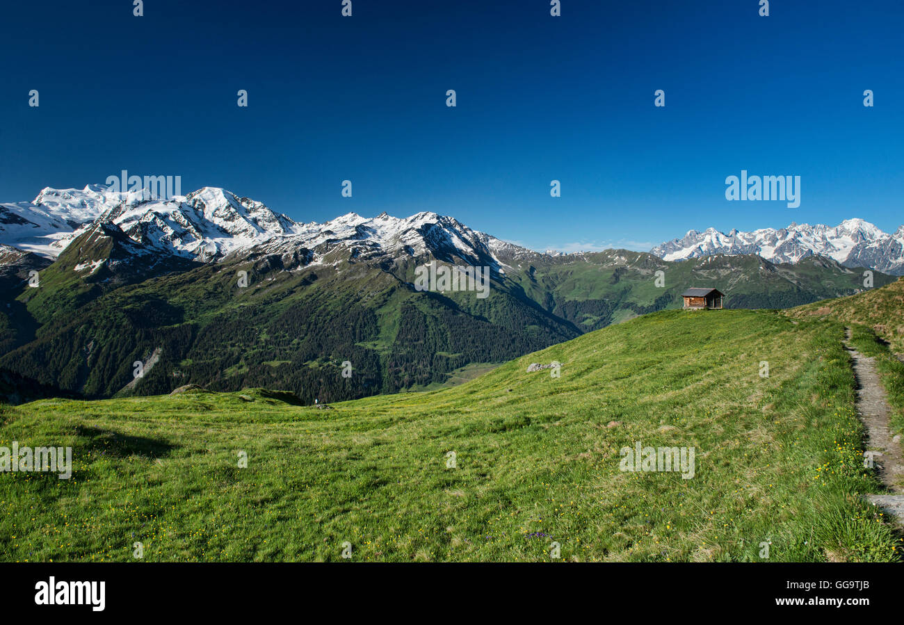 View of the Grand Combin and Mont Blanc massifs from Cabane Mont Fort on the Haute Route, Val de Bagnes, Switzerland - Stock Image
