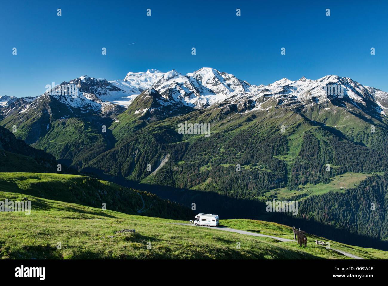 World's best campspot, RV parked overlooking the Grand Combin above Verbier, Val de Bagnes, Switzerland - Stock Image