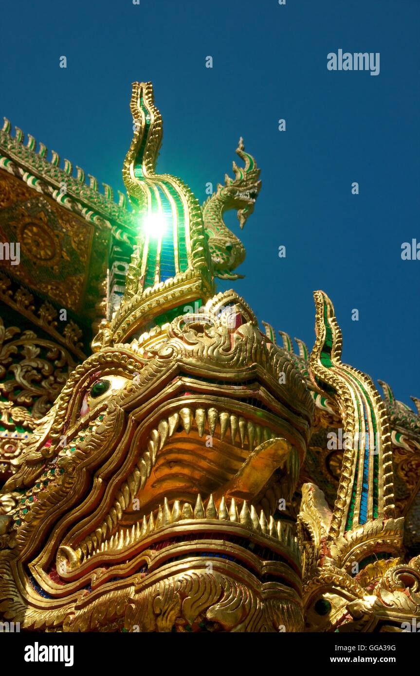 Nagas (mythical creatures) guarding the entrance to Wat Mahathat, Lamphun, Thailand. - Stock Image